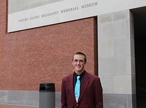 Tyler Merrill ourside the United States Holocaust Memorial Museum