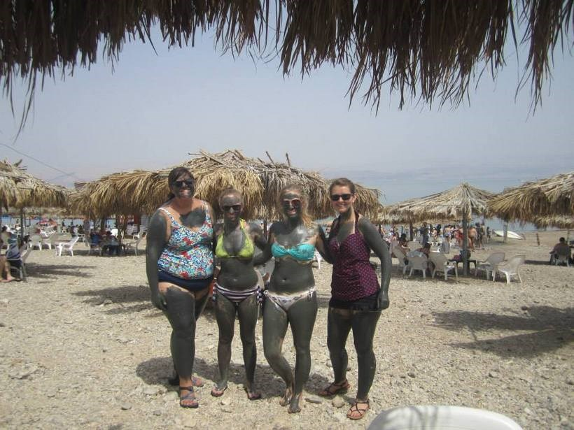 Students covered in mud at the beach