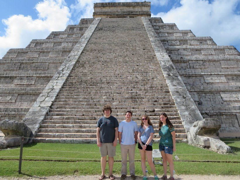 Students in front of a huge temple in the Yucatan