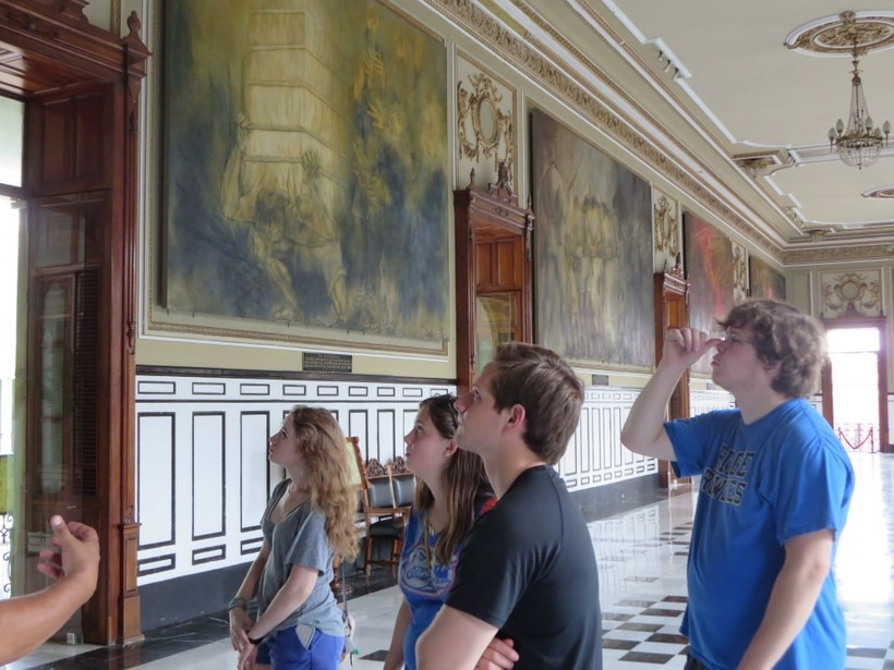 Students looking at artwork inside a building