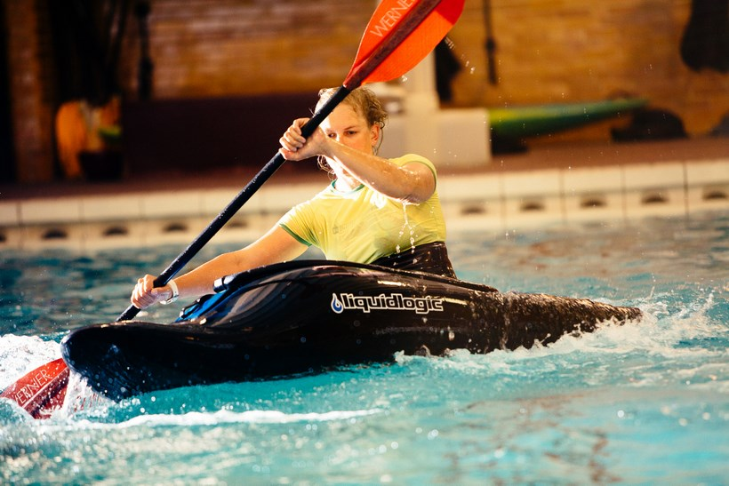 Student kayaking in the pool