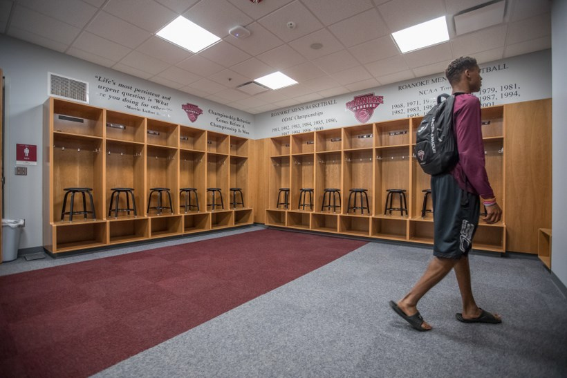 A student walking in the Cregger Center mens' locker room