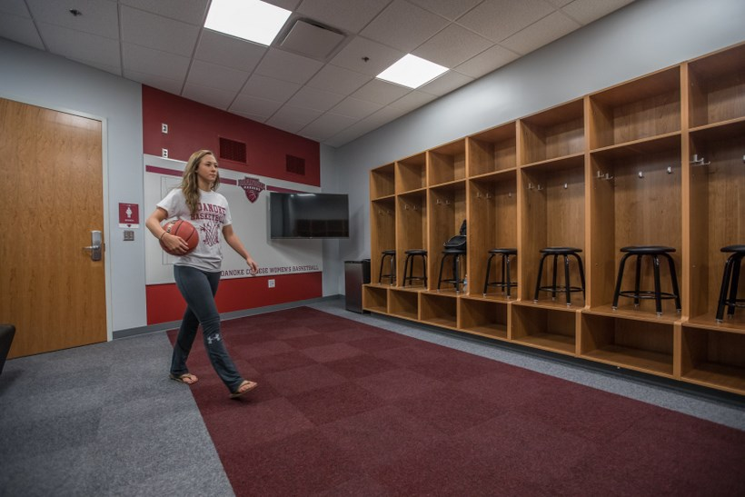 A student walking in the Cregger Center womens' locker room