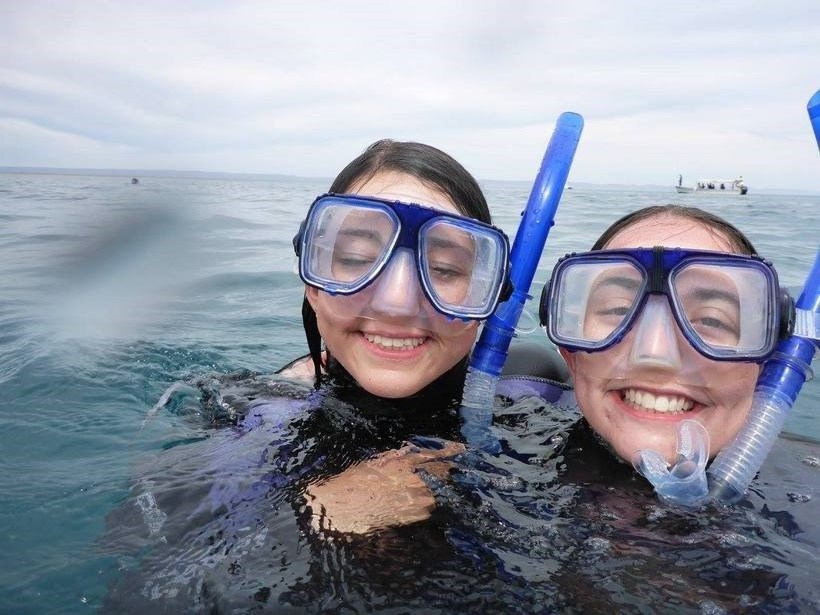 Students just above water level while snorkeling