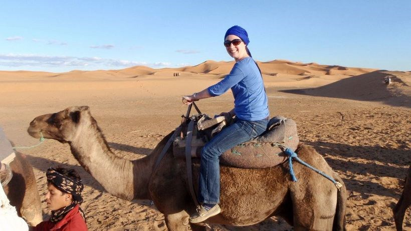 Student riding on a camel