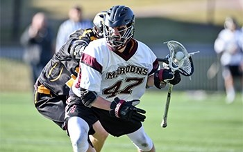 A roanoke college student playing lacrosse number 42