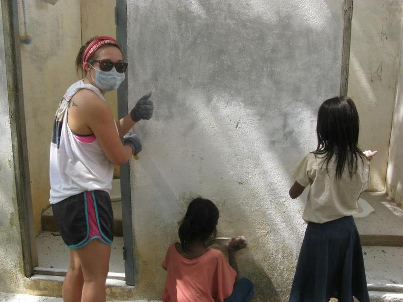 Students working with members of a community in Cambodia