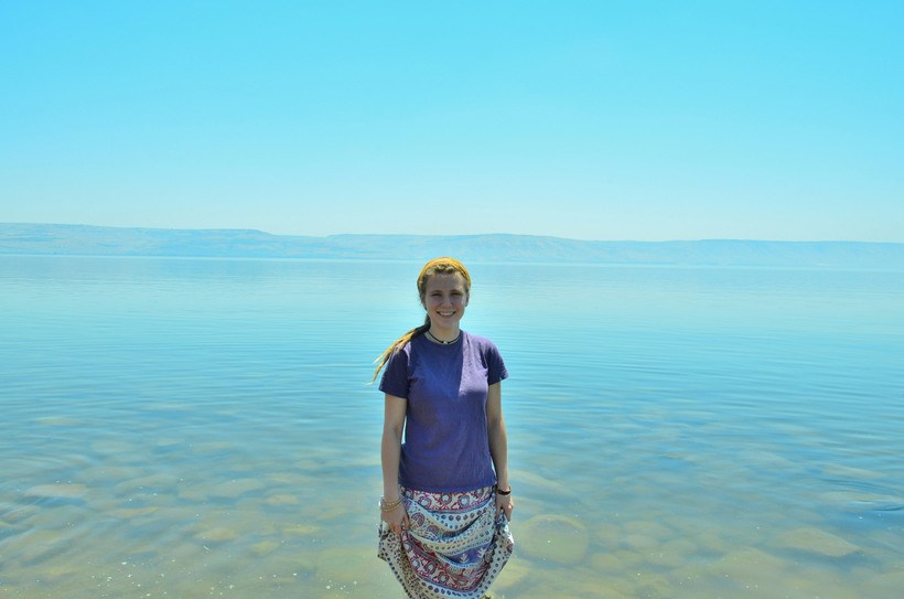 Student in front of the Sea of Galilee