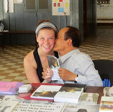 Student with an author from Cambodia