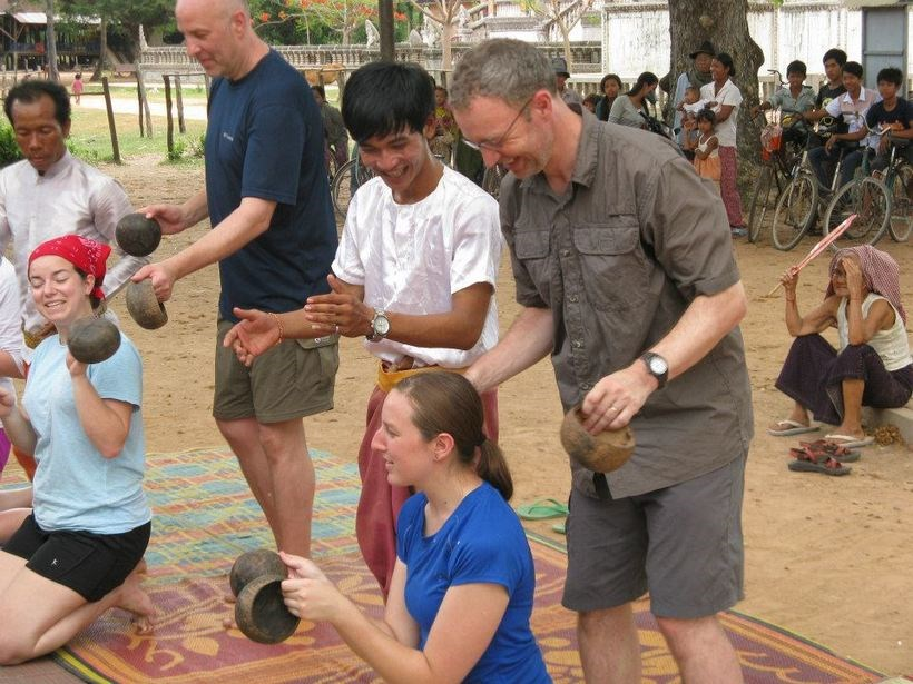 Students having fun with community members in Cambodia