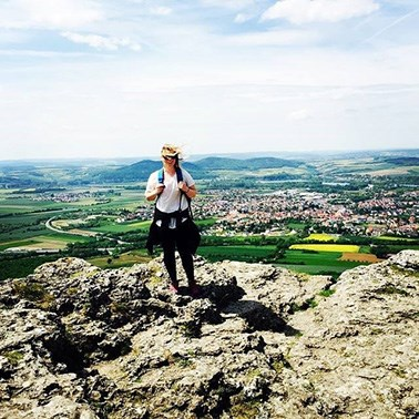 Student standing on a rocky ledge in Germany