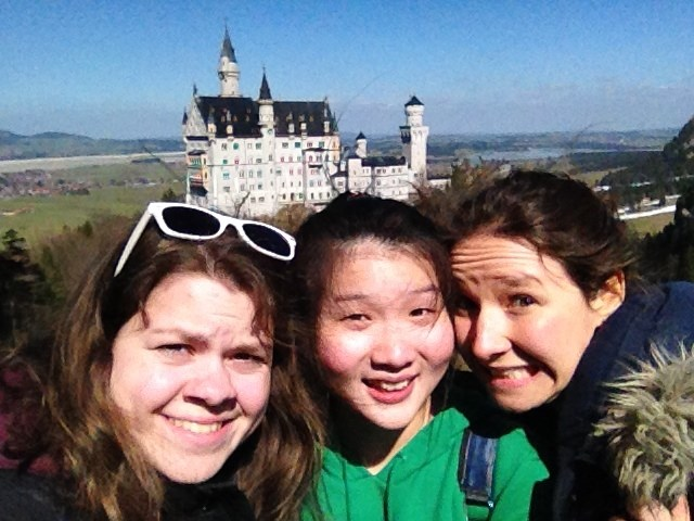 Selfie of students with a castle in the background