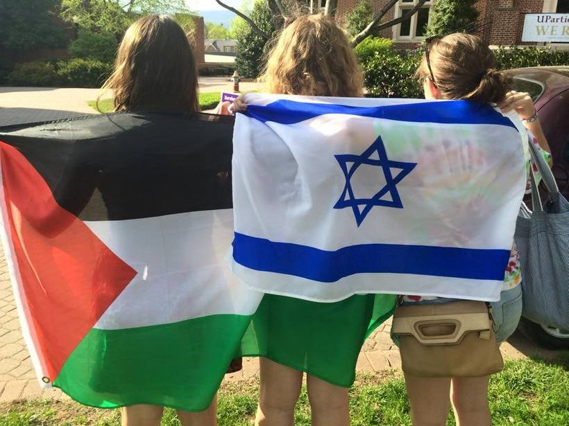 Students holding flags from different countries