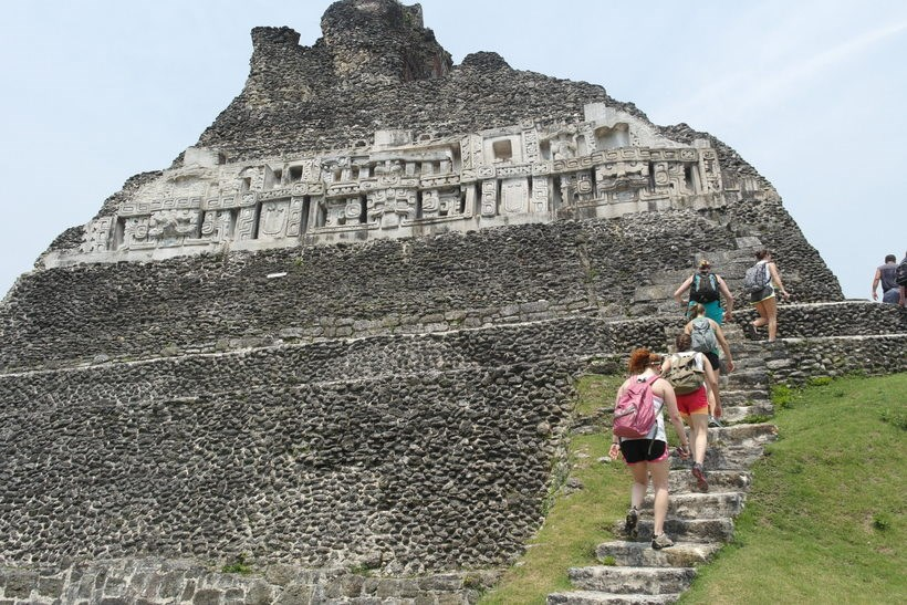 Students climbing up steps to ruins in a Latin American country