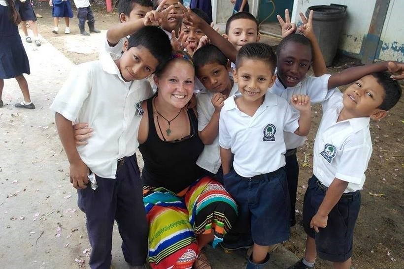 Student with children in a Latin American country