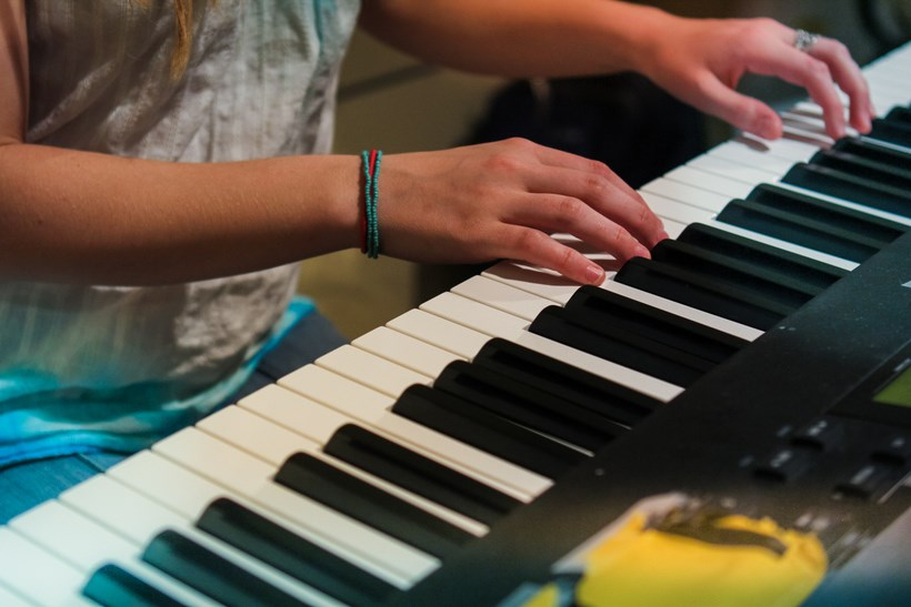Closeup of student playing the piano