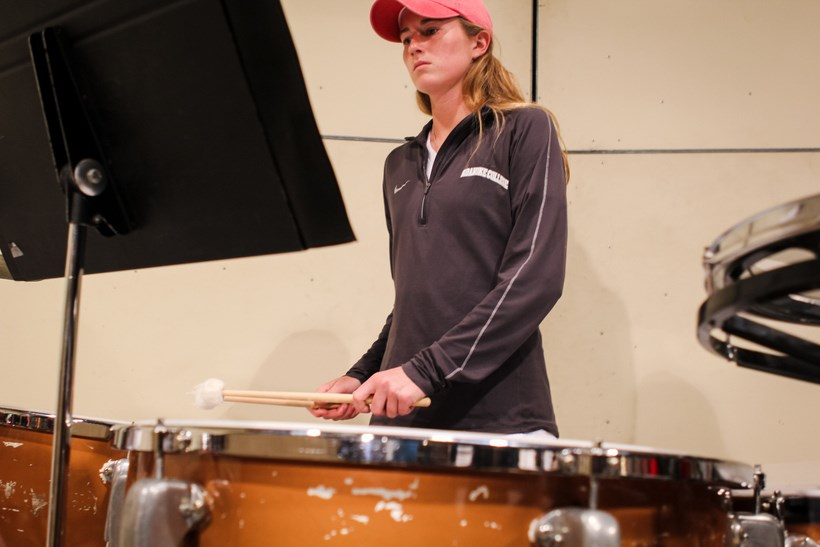 Student playing the timpani