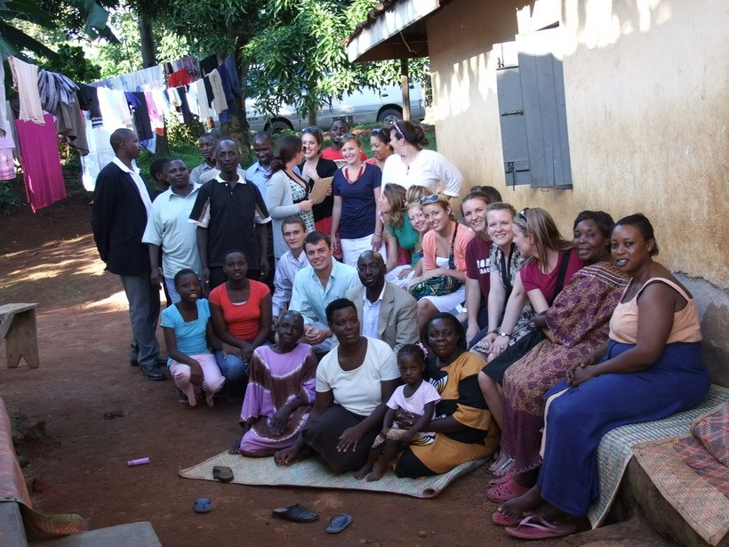 Students and Dr. Rubongoya with community members
