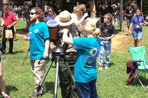 Park ranger viewing the eclipse at a point of totality