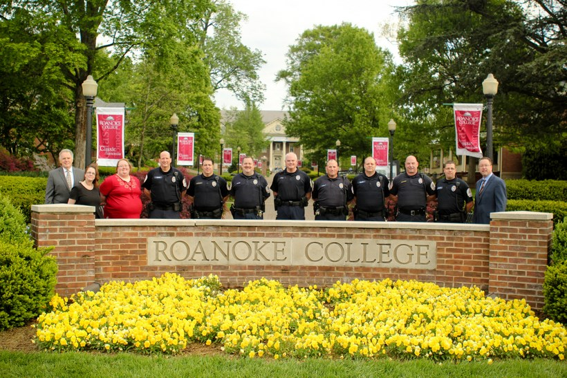 Campus Safety posing by the Roanoke College sign