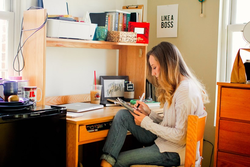Student working in her dorm