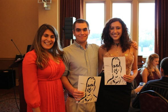 Honors students posing with a drawing of their mentor