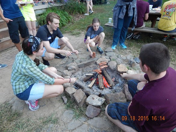 Students work together to build a bonfire for their outdoor picnic