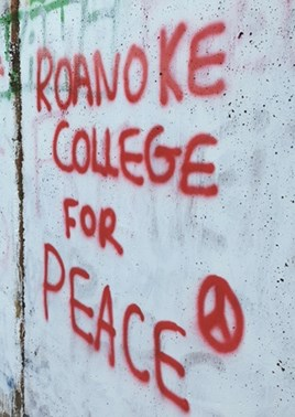 Roanoke College For Peace spray painted on The Rock