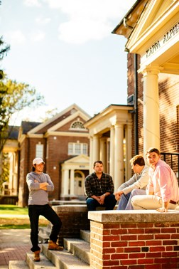 Students hanging out outside Kappa Alpha Order