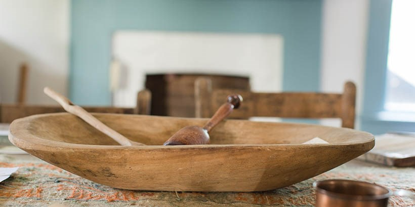 A bowl and spoon on the table in the renovated slave quarters