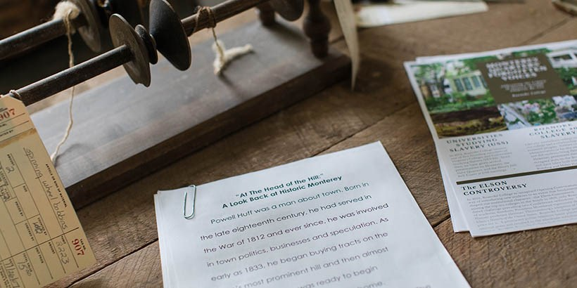 An old letter and other artifacts on a table