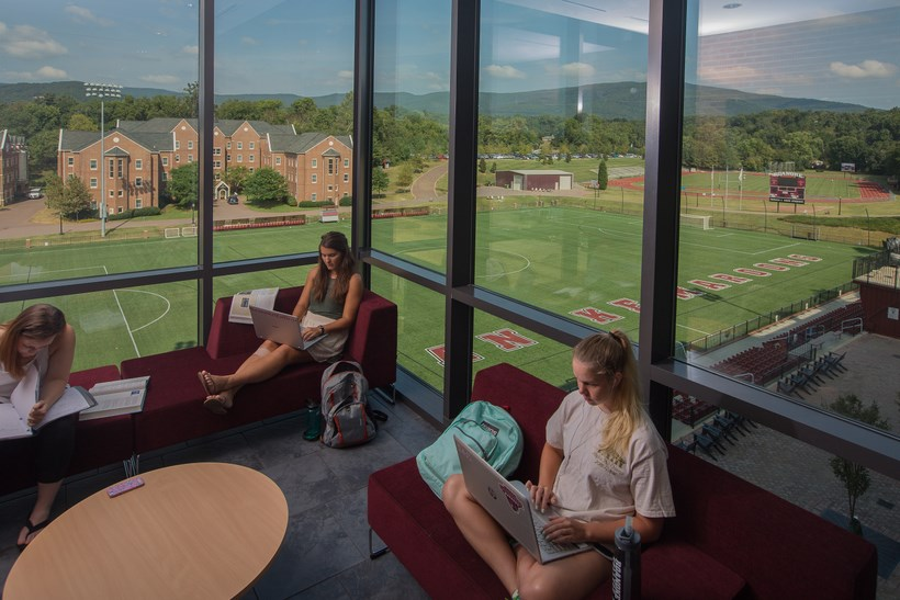 Students relaxing in the lounge of the Cregger Center