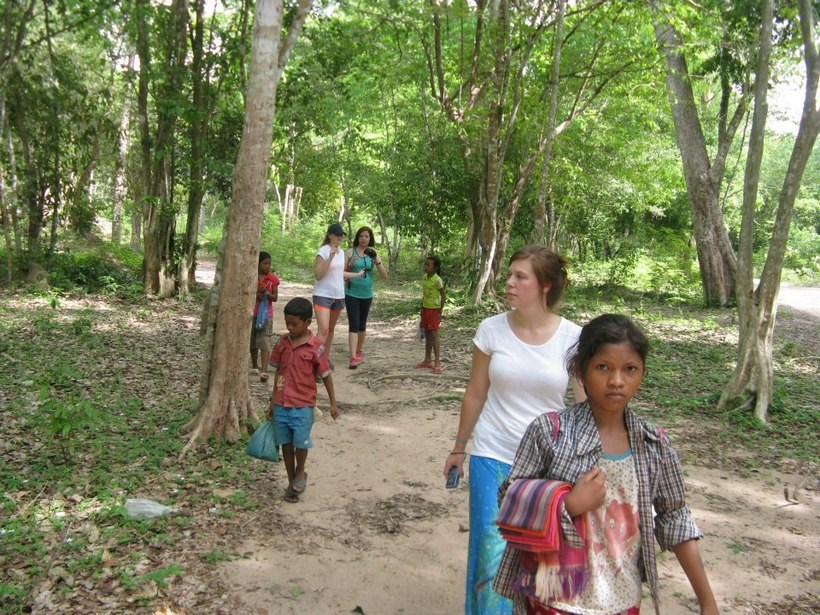 Students walking with children in Cambodia