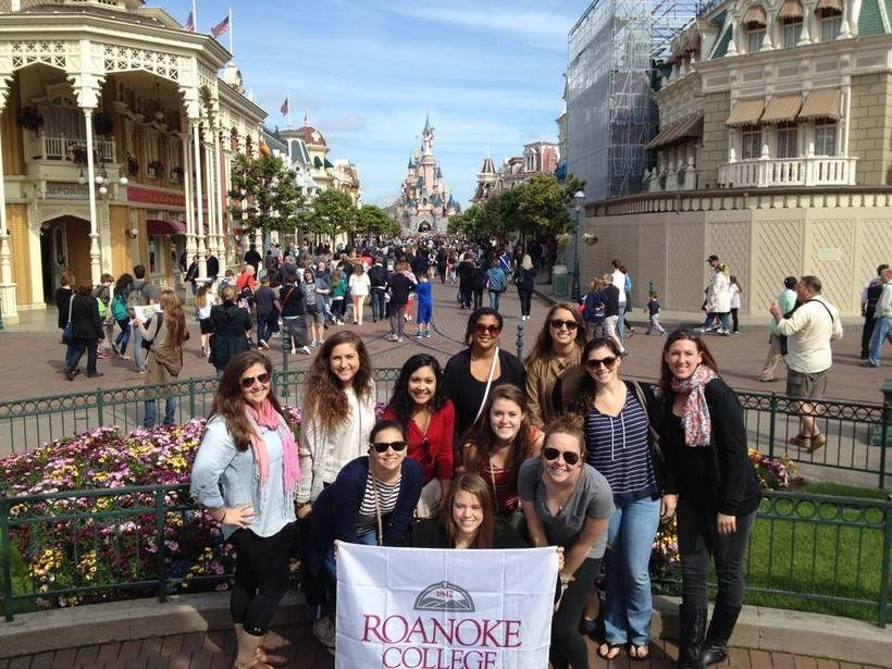 Students in Disneyland Paris with a roanoke college banner