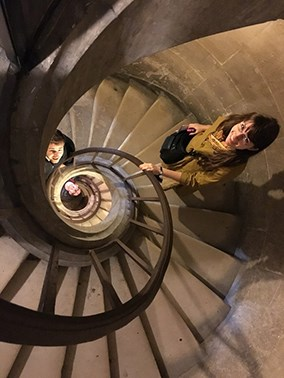 Photo from above of students on a spiral staircase
