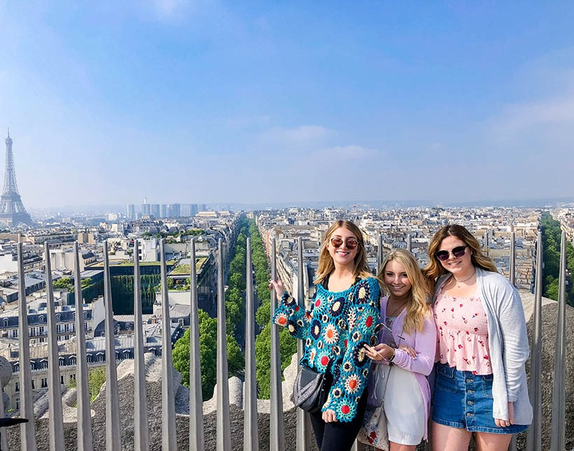 Students at a lookout looking over the city of Paris