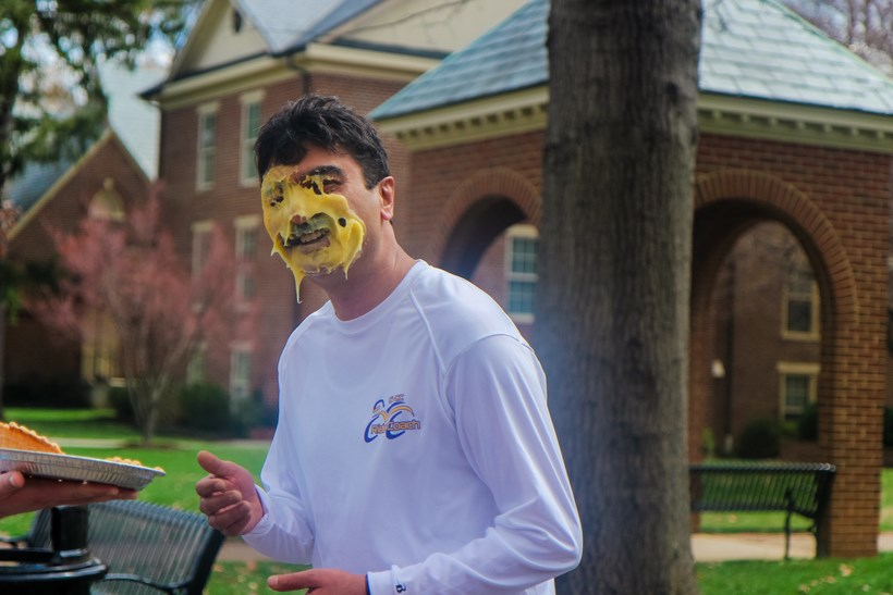 Student with pie all over his face