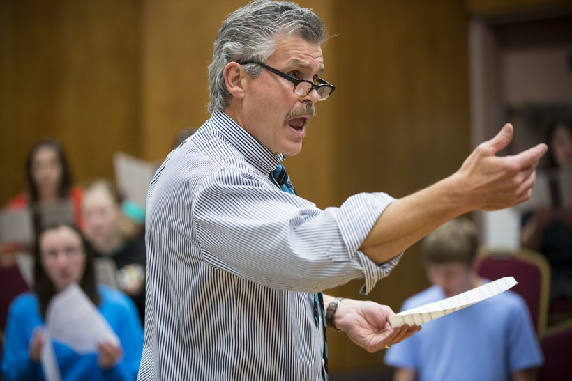 the choral director conducting the chorus