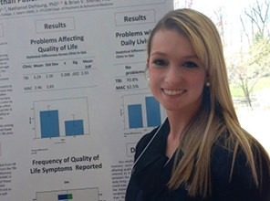 Photo of student presenting her research