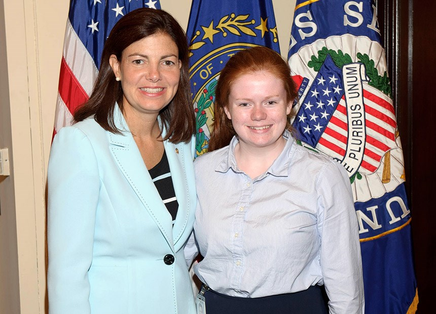 Student Ariel Starkey posing for a photo with a senator