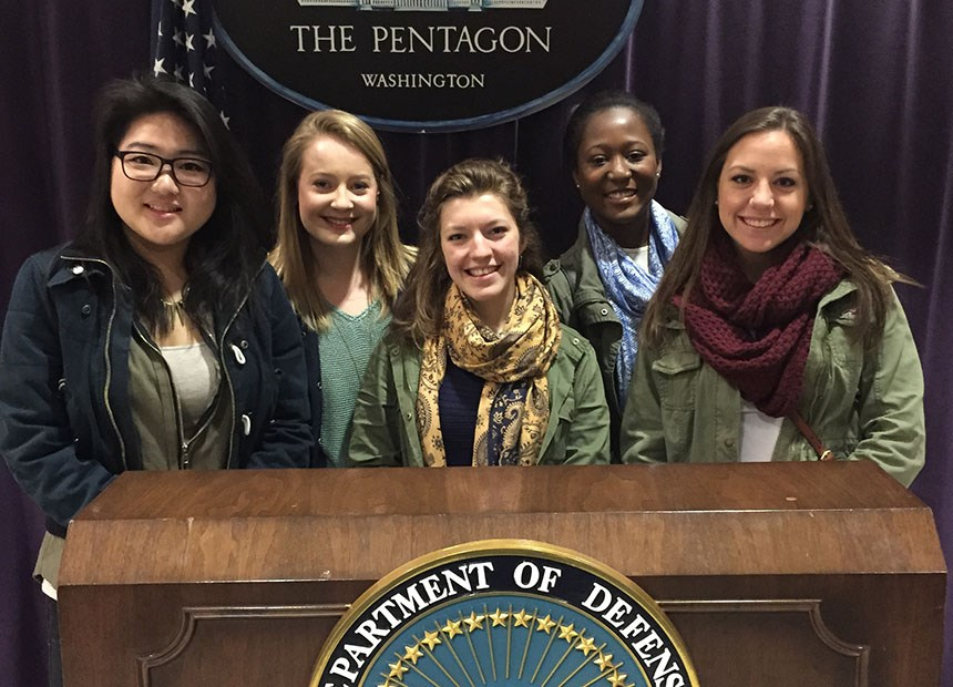 Students behind the podium for the United States Department of Defense