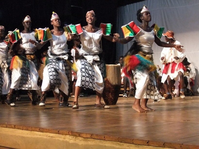 Ugandan community members participating in a traditional dance