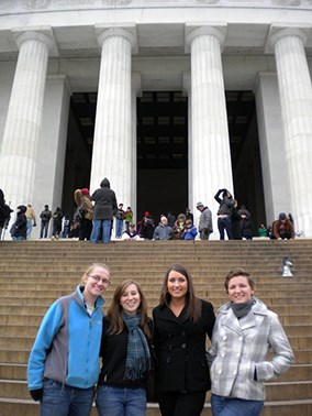 Students outside a memorial