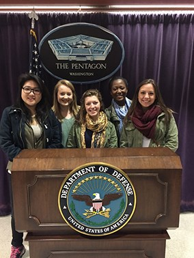 Students behind the Department of Defense podium