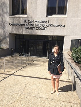Student in front of the Family Court building