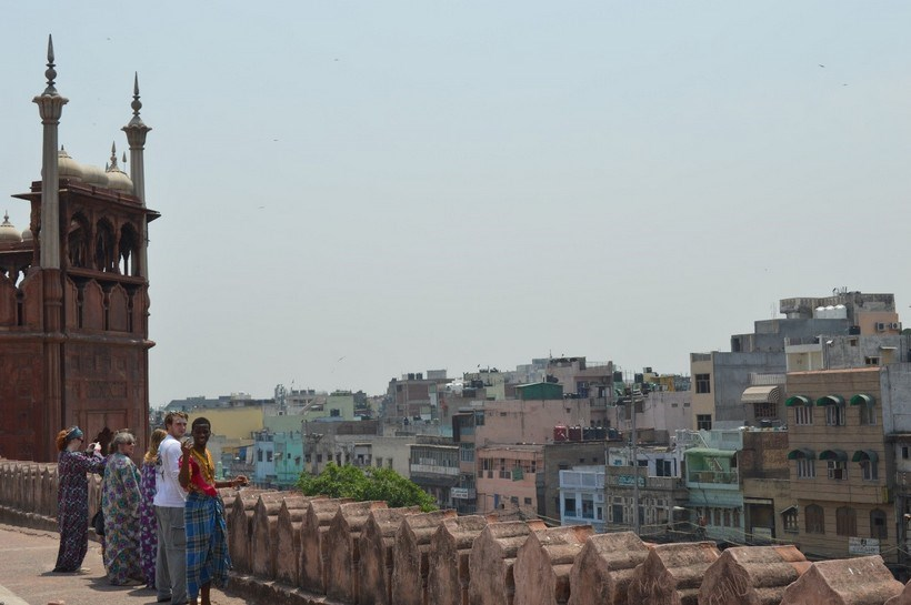 Students looking over a city in India