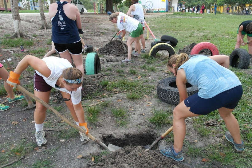 Students digging holes for tires