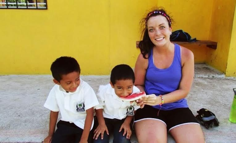 Student with two children in Belize