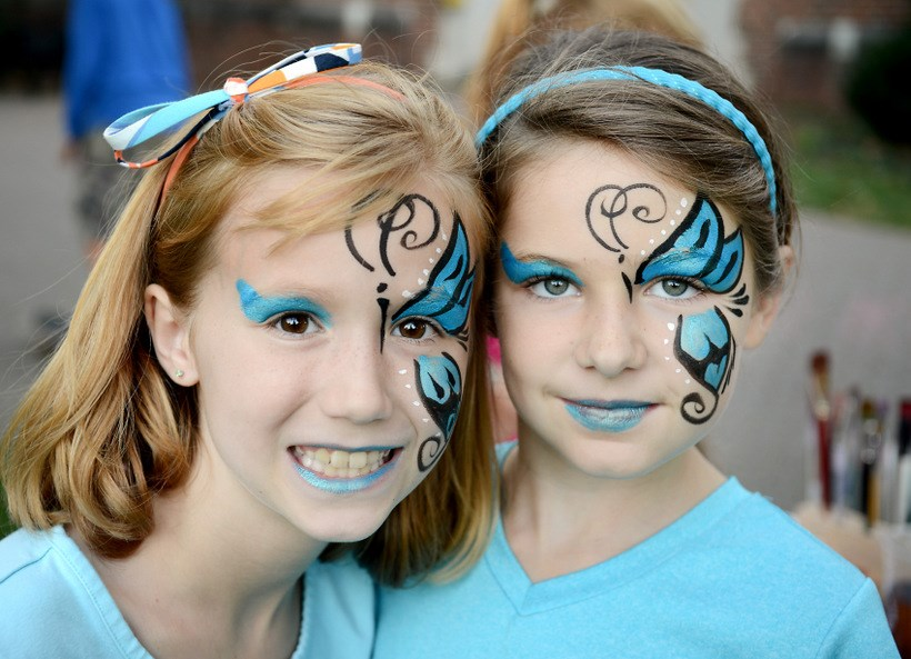 Siblings of students with face paint