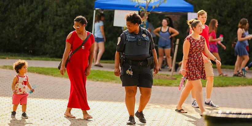 A mom, her child, and a campus safety officer